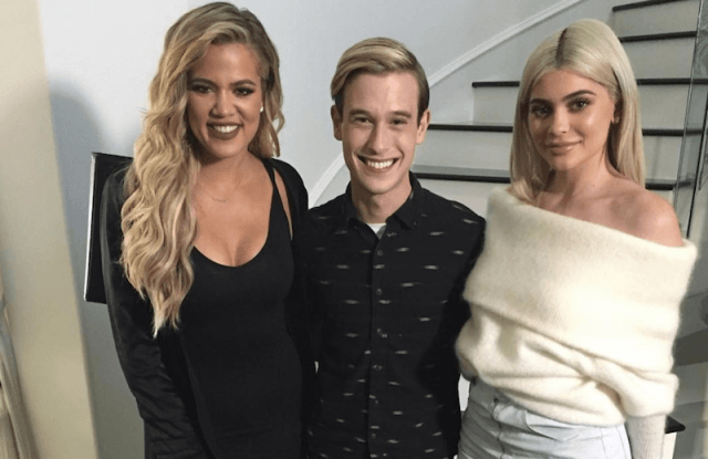 Tyler Henry stands with Khloé and Kylie Jenner.