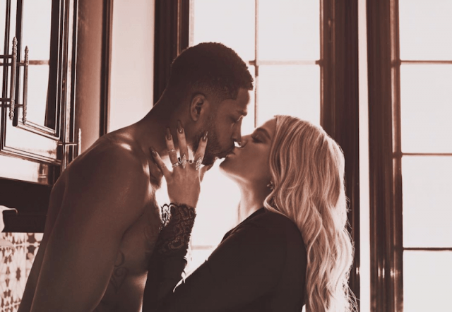 Khloé Kardashian and Tristan Thompson kiss during their photoshoot.