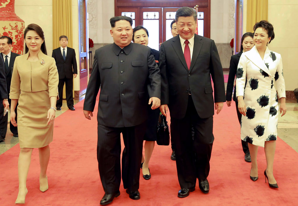 North Korean leader Kim Jong Un and his wife, Ri Sol Ju, with China President Xi Jinping