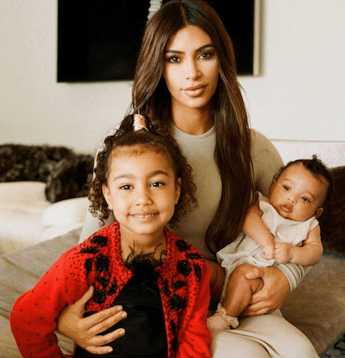 North Wes posing with her mother, Kim Kardashian West and Chicago.