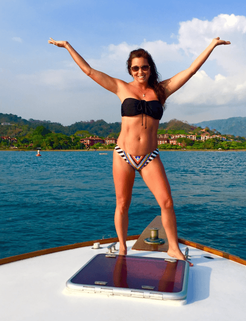 Laura Avon posing on a boat.