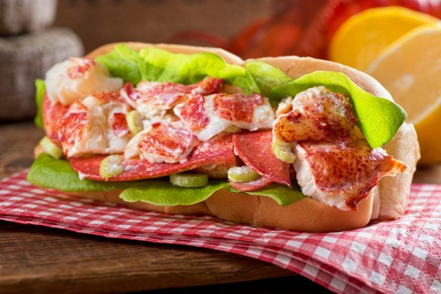 A lobster roll on a plate.