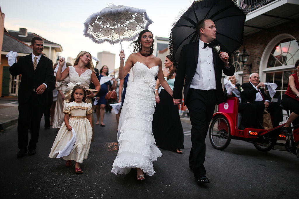 Landrum Hughes and Julie Hughes celebrate their wedding with a 'second line' parade through the French Quarter