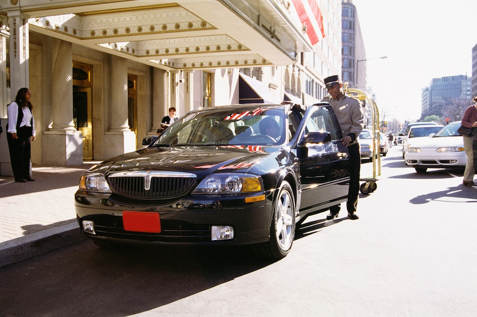 Luxury car and valet attendent