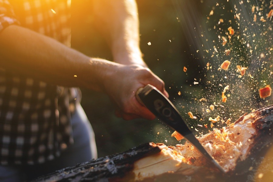 Man cutting wood with axe