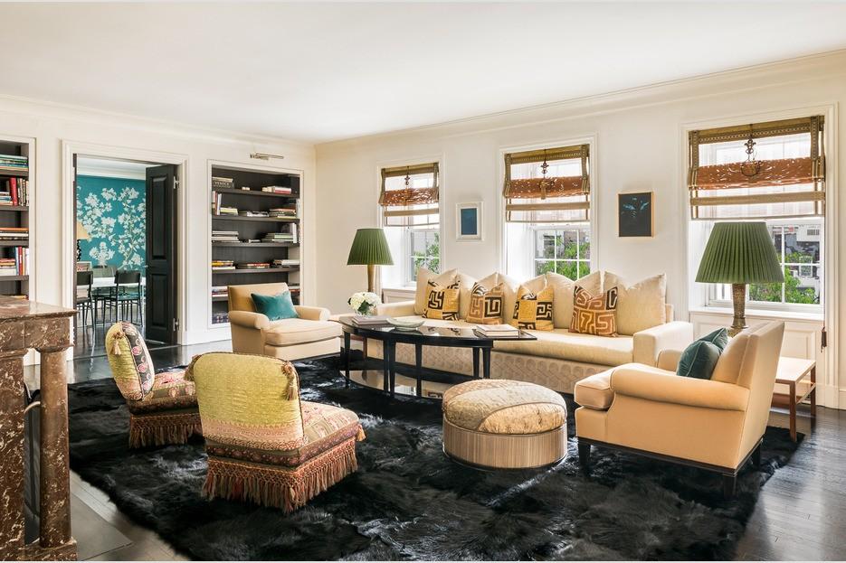 Beige large living room with built in bookshelves