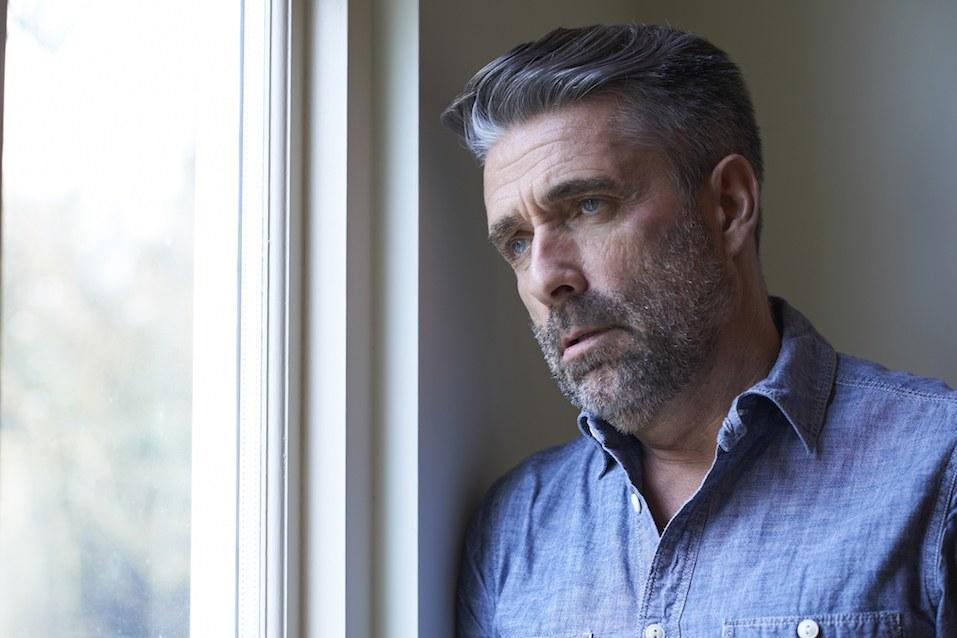 Mature Man looking sad