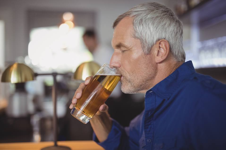 Mature man drinking