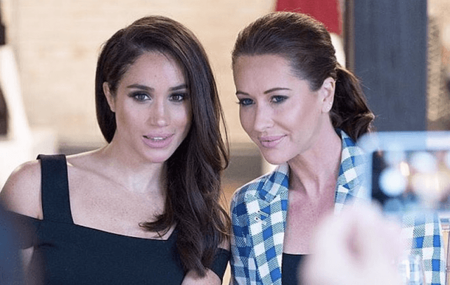 Meghan Markle sitting at a dinner table with Jessica Mulroney.