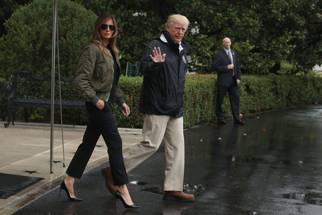 Donald Trump walks with Melania Trump prior to their Marine One departure