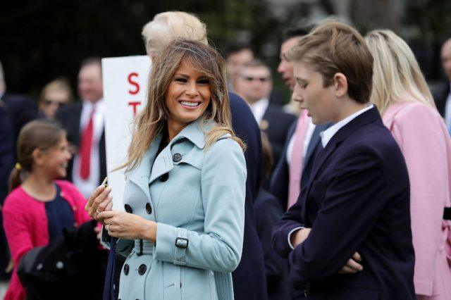 Melania Trump smiles over at Barron Trump.