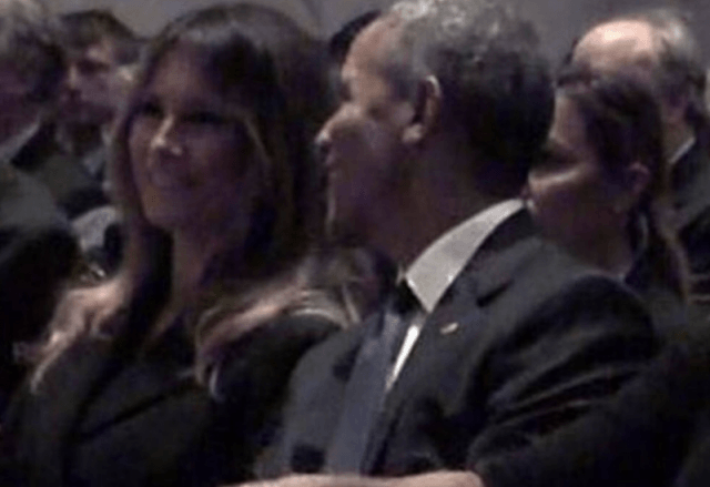 Melania and Barack sitting next to each other at Barbara Bush's funeral service.