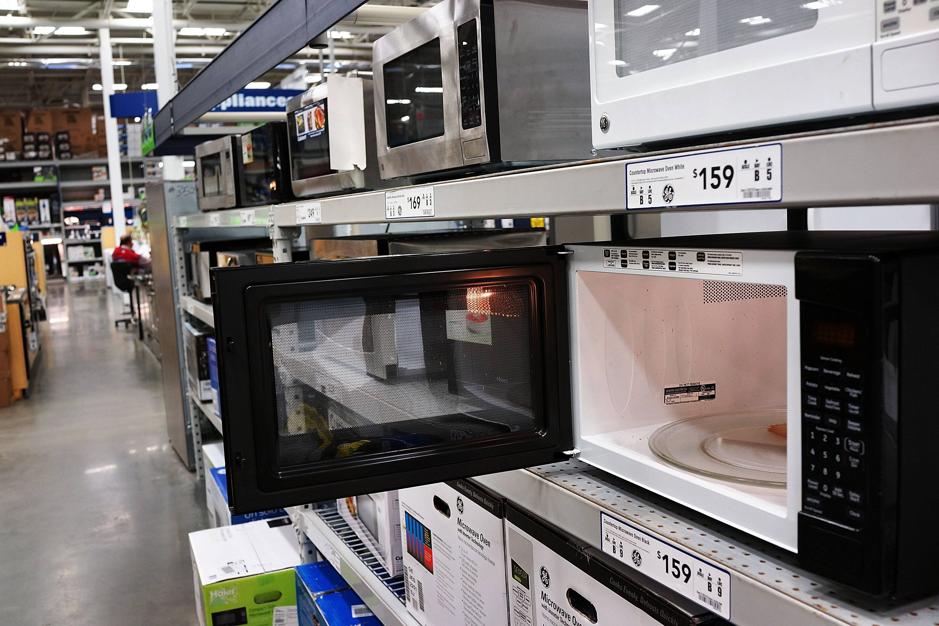Microwave ovens are on display in a home furnishing store