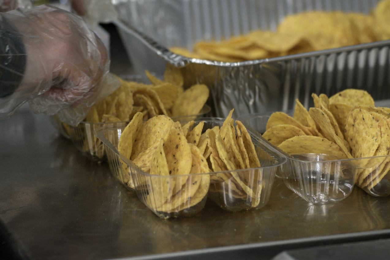 Plastic Gloved Hand Preparing Concession Nachos Tortilla Chips Snack Food