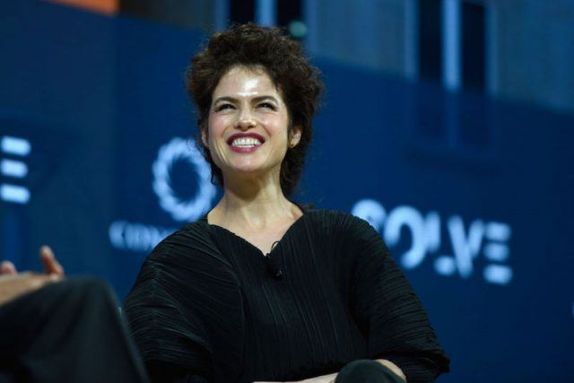 Dr. Neri Oxman smiling while on stage.