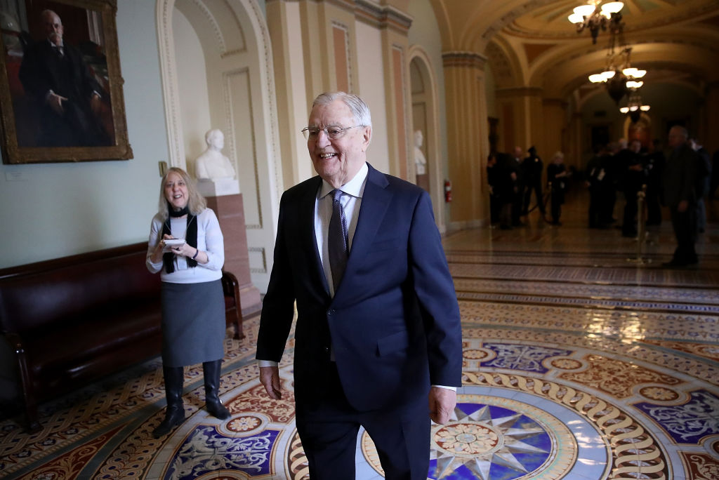 Former U.S. Vice President Walter Mondale walks outside the U.S. Senate chamber