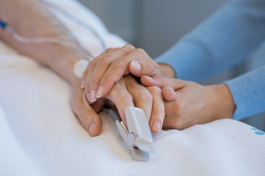 Hands of Patient lying on bed