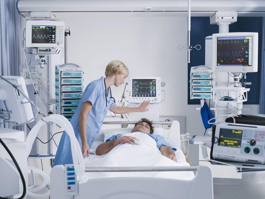 Nurse looking at patient