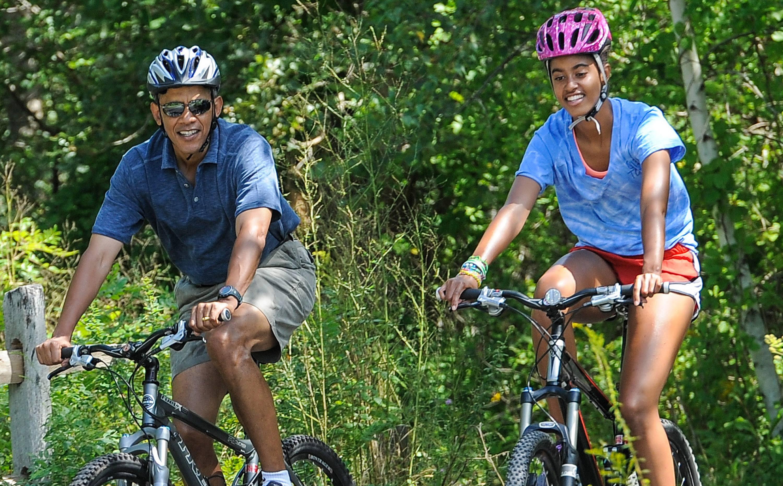 President Barack Obama rides bikes with daughter, Malia