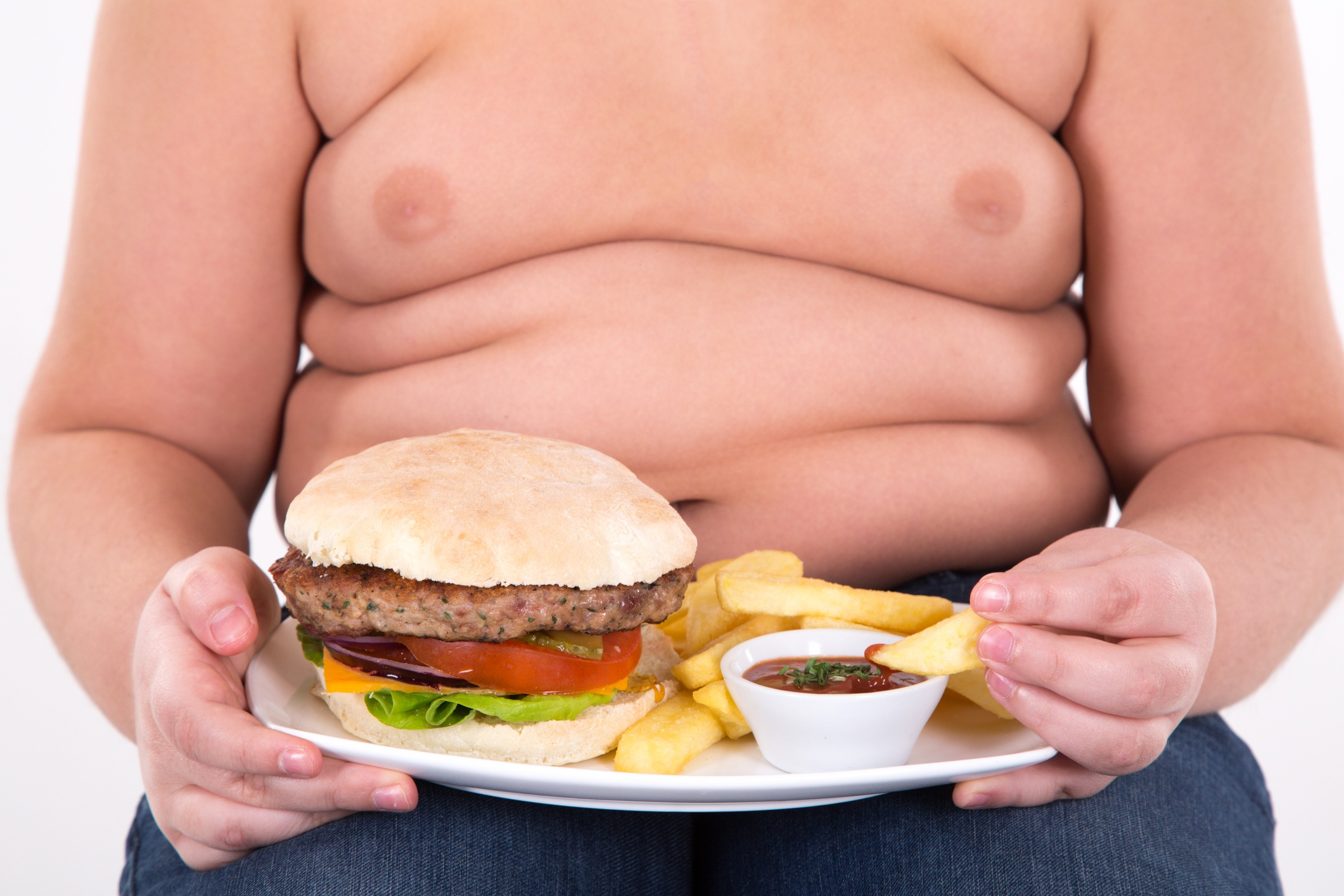 Obese child with hamburger and fries