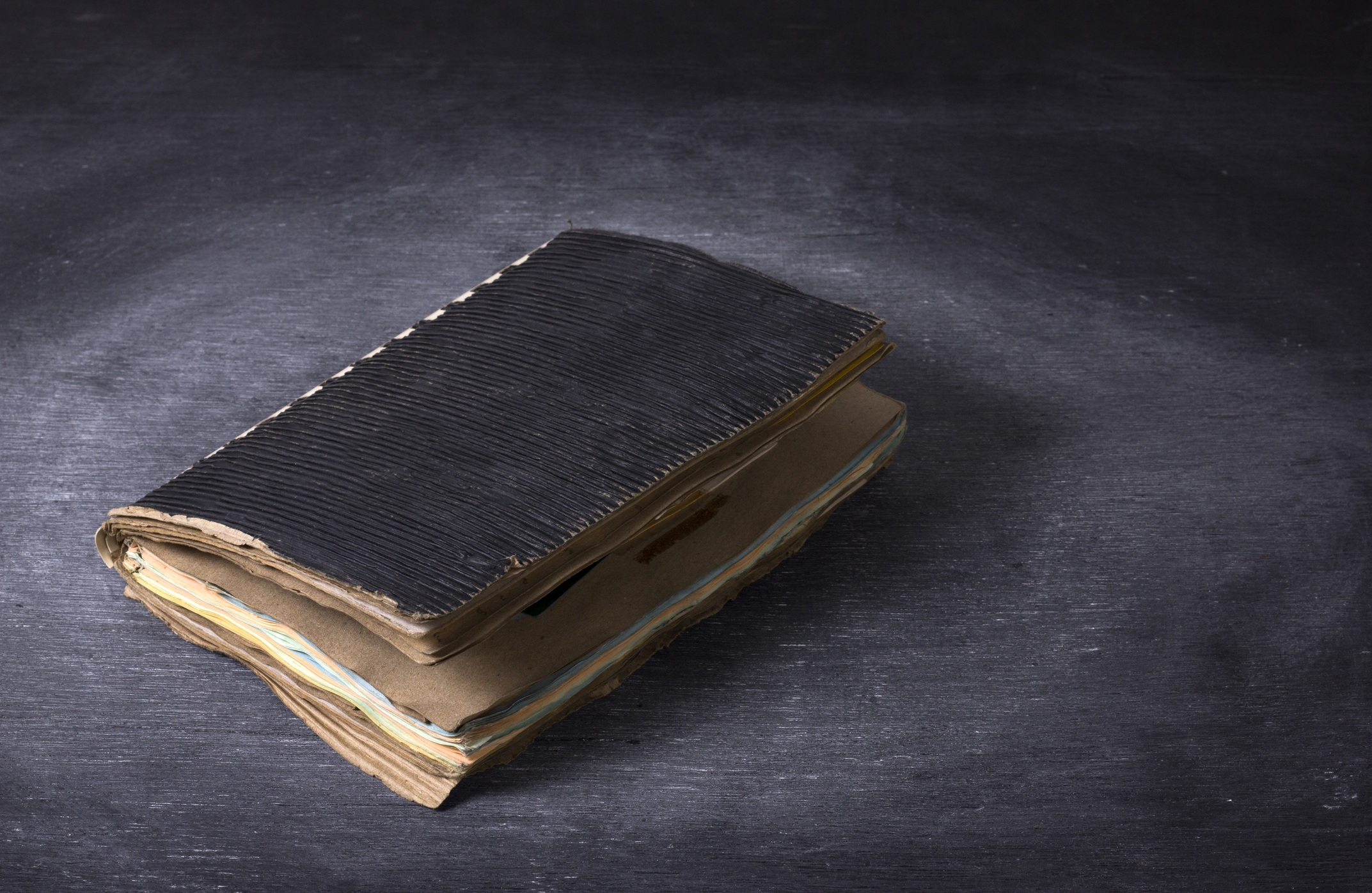 Ancient notebook open on the wood texture.