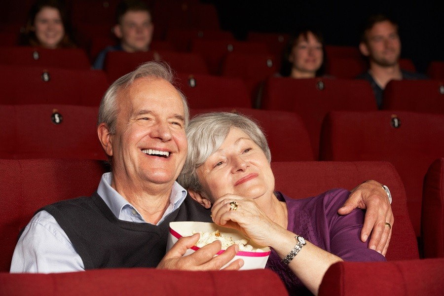 Senior couple at the movies watching a film