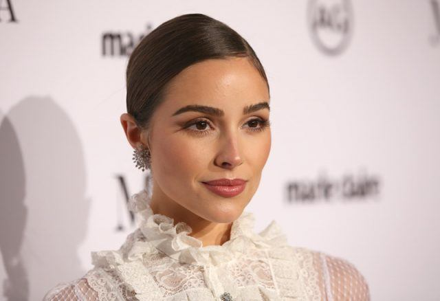 Olivia Culpo posing on a red carpet.