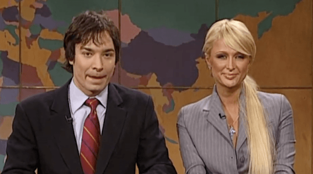 Paris Hilton and Jimmy Fallon sitting at the news desk.