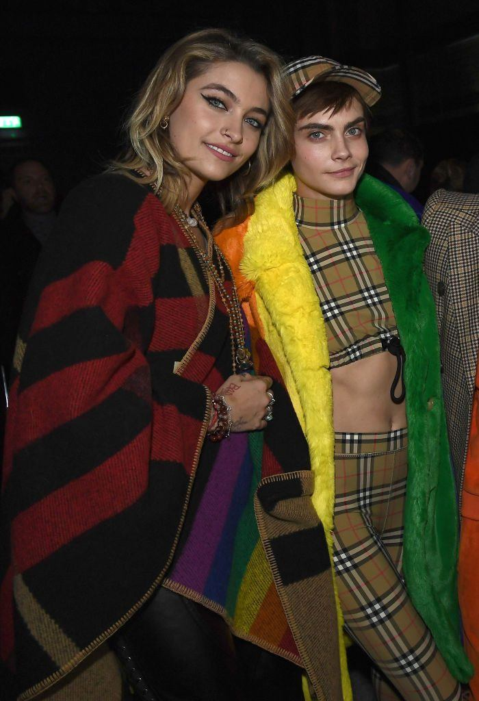 Paris Jackson and Cara Delevingne wearing Burberry at the Burberry February 2018 show