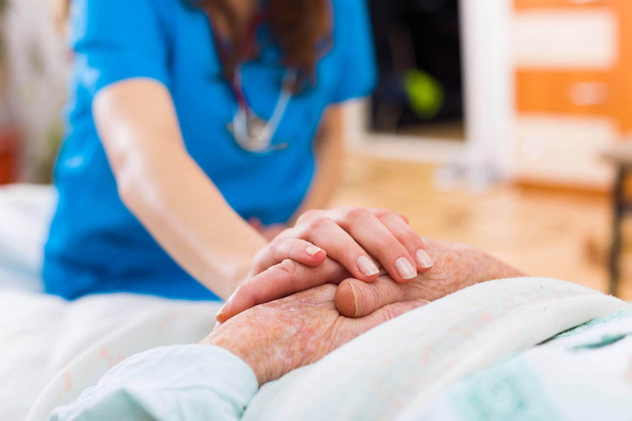 Nurse holding Patient hands