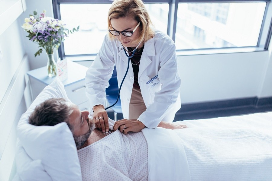 Doctor and Patient lying on bed