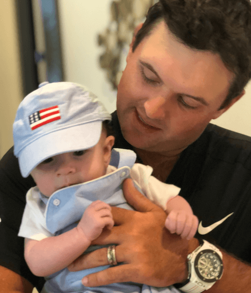 Patrick Reed and his son.