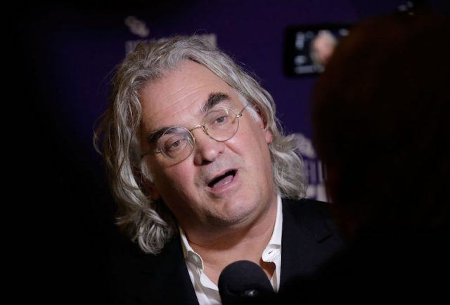 Paul Greengrass being interviewed by press on a red carpet.