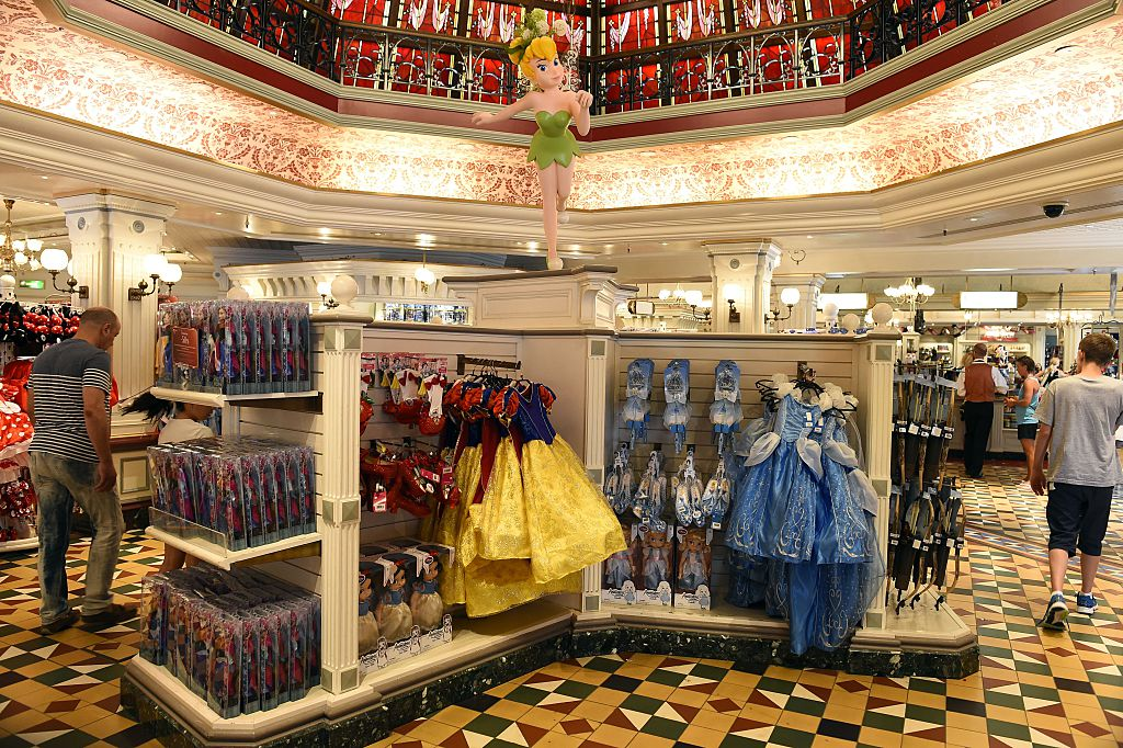 People walk in the Disney Store in Mean Street at Disneyland Paris