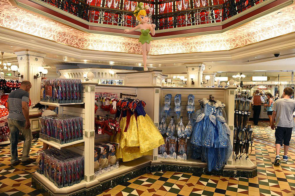 People walk in the Disney Store in Mean Street at Disneyland Paris