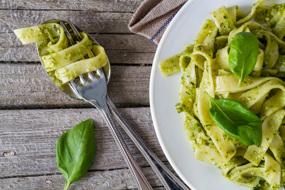 Pesto pasta on white plate