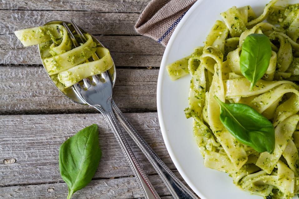 Pesto pasta on white plate