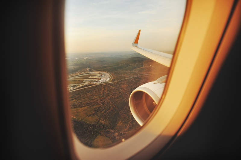 The view from inside of a plane to the outside through the window