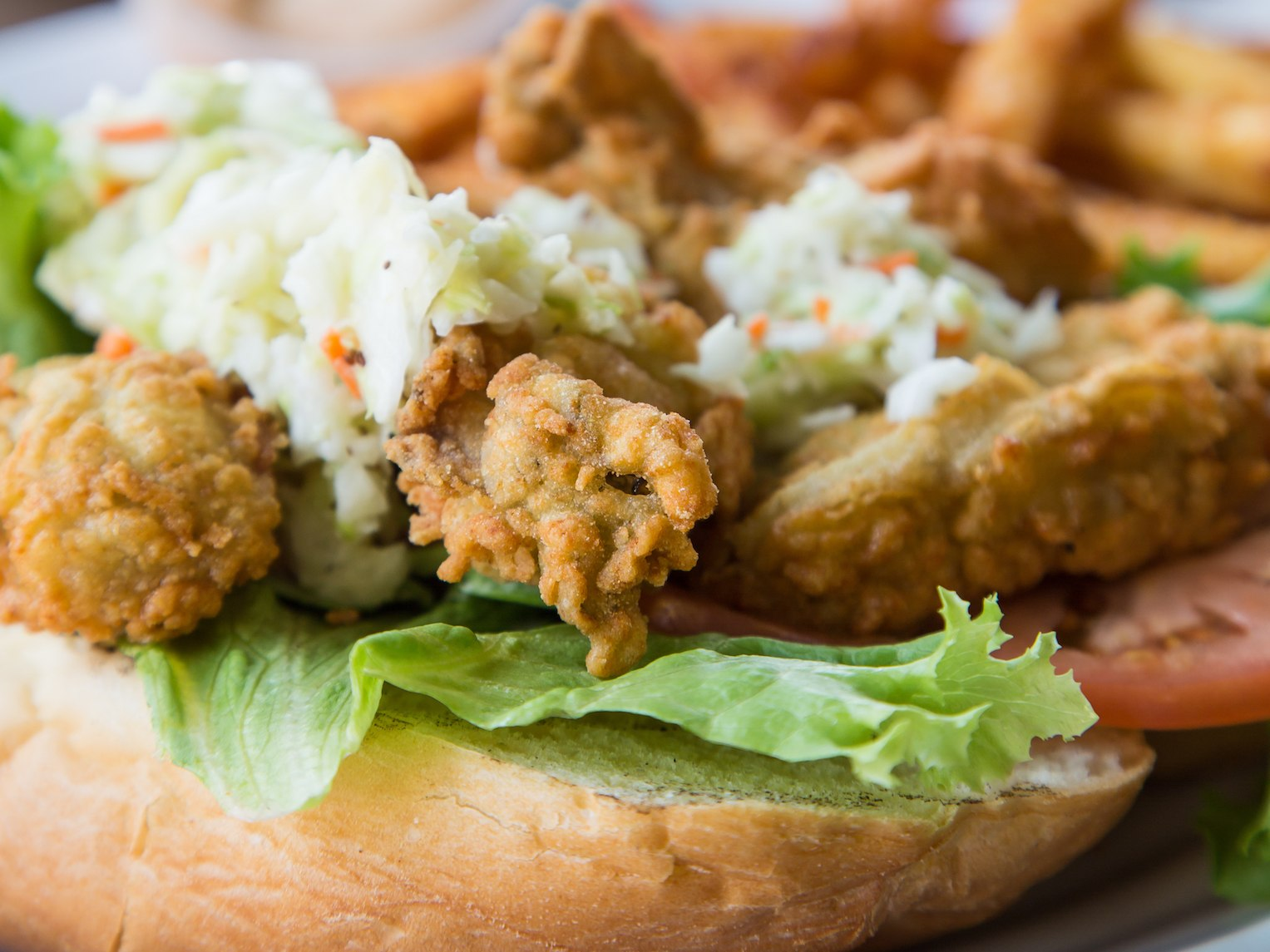 Fried Oyster Po-Boy Sandwich Topped with Cole Slaw
