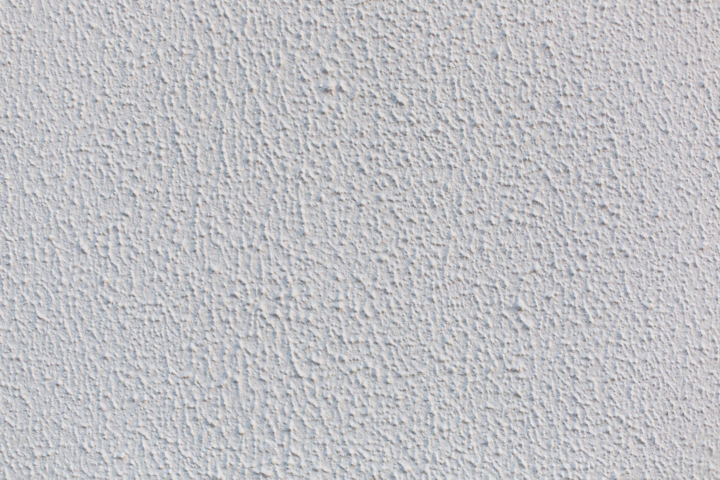 White popcorn ceiling wall