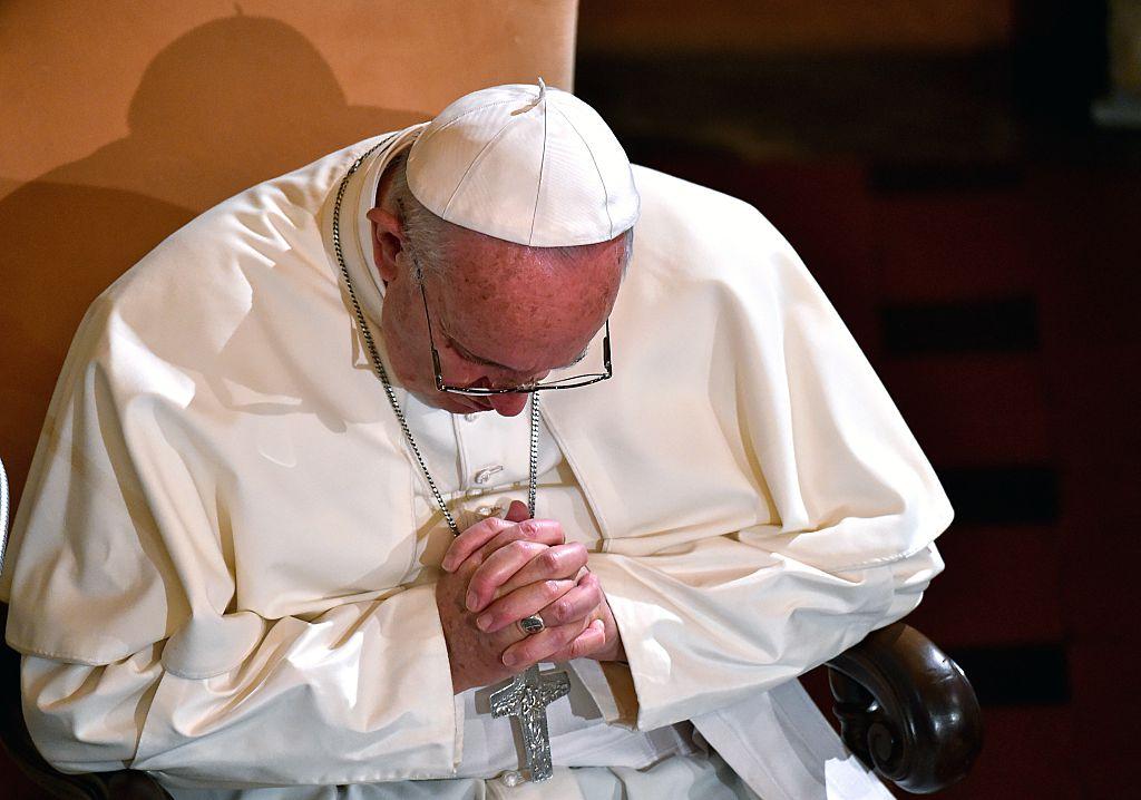 Pope Francis praying
