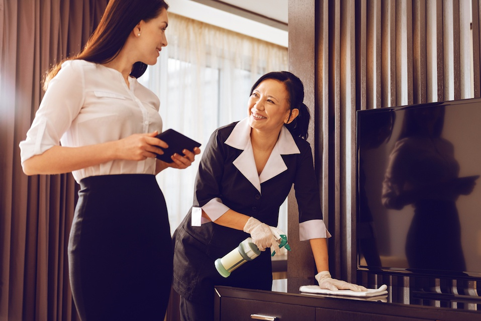 Attendant talking with room guest