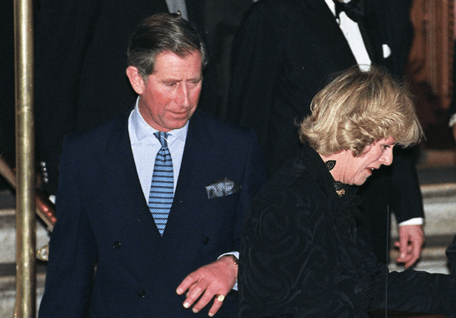 Prince Charles and Camilla Parker Bowles entering a car together after attending a formal event.