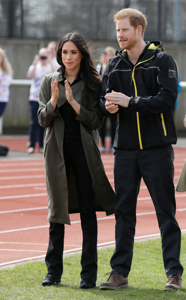 Prince Harry, Patron of the Invictus Games Foundation, and his fiancee Meghan Markle applaud as they attend the UK Team Trials