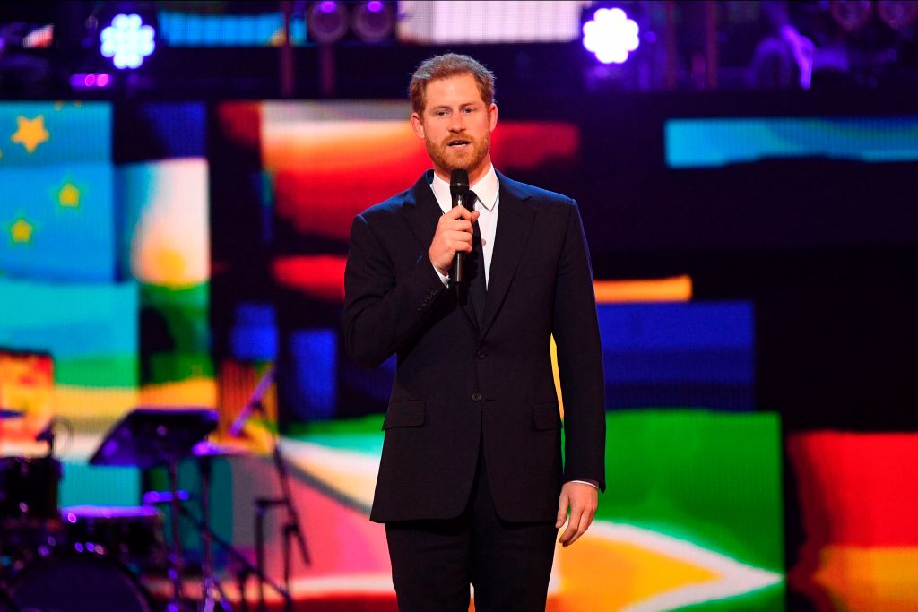 Britain's Prince Harry speaks on stage at The Queen's Birthday Party