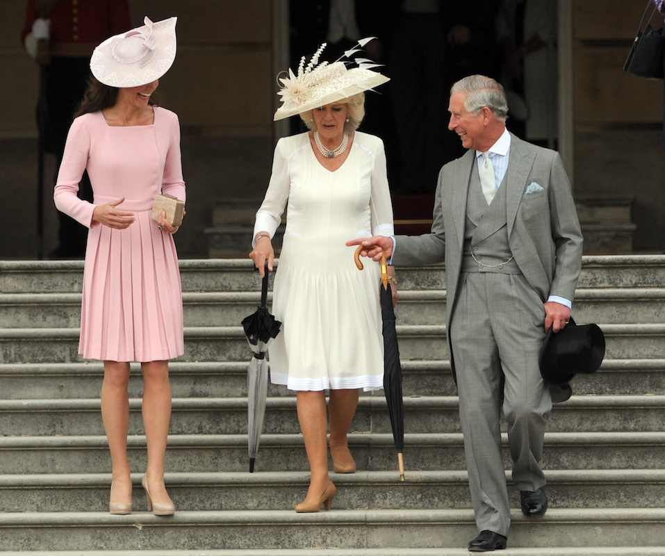 Catherine, Duchess of Cambridge, Camilla, Duchess of Cornwall and Prince Charles, Prince of Wales attend a garden party at Buckingham Palace