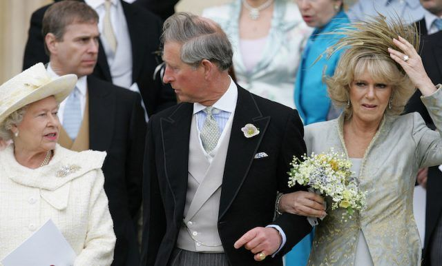 Queen Elizabeth speaks with Prince Charles, who has linked arms with Camilla Parker Bowles.