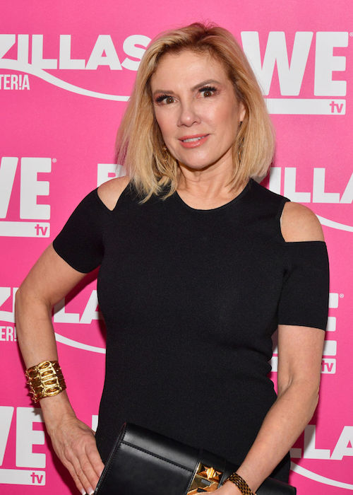 Ramona Singer standing on a red carpet in a black dress.