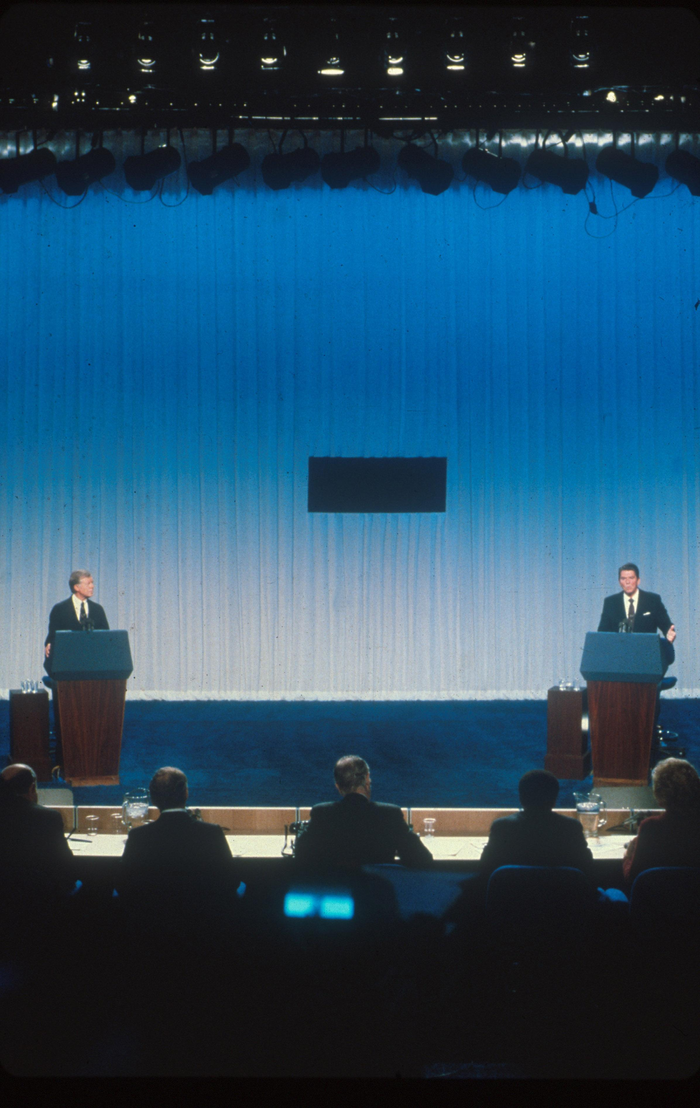 immy Carter and Ronald Reagan debate each other