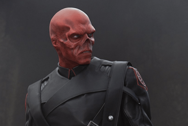 Red Skull looking to the side while in uniform.